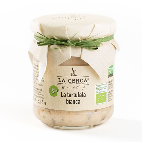 LA TARTUFATA BIANCA - Ingredienti: panna*, tartufo bianchetto (Tuber borchii Vittad.)* 5%, formaggio (Parmigiano Reggiano DOP)*, farina di riso*, tartufo bianco (Tuber magnatum Pico)* 1%, aroma naturale *, sale. * da agricoltura biologica ITALIANA.Peso netto: 90g e 180g.Scadenza e modalità di conservazione: 36 mesi dalla data di sterilizzazione, dopo l'apertura conservare in frigo a +2°- +4° per max 7gg.Confezioni: vasi in vetro.Uso consigliato: Molto versatile, arricchisce qualsiasi pietanza. Ideale per antipasti, primi piatti, secondi di carne. 100% TARTUFO ITALIANO, Regione Marche. Senza conservanti, additivi e coloranti; con aroma naturale Biologico.