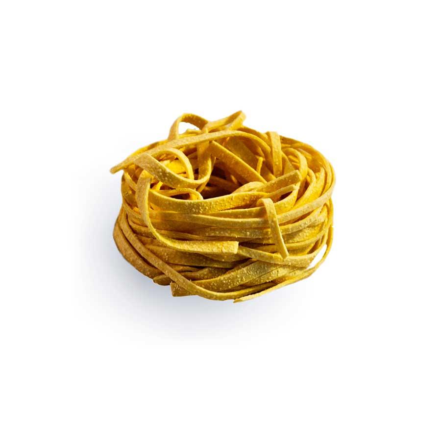 TAGLIATELLINE - Descrizione: Pasta all'uovo essiccata. La sfoglia sottile e porosa, la consistenza piena e corposa delle Tagliatelline; rendono questa pasta all'uovo, nata in un territorio incontaminato come quello del Balcone delle Marche, un prodotto d'eccellenza.  Questo formato classico è da provare accompagnato con del buon tartufo bianco di Acqualagna (PU).  Ingredienti: Semola di grano duro, uova pastorizzate (28%), sale.Tempo di cottura: 4.30 -5.00 minutiModalità di conservazione: Conservare in luogo fresco e asciutto, lontano da fonti di caloreShelf-life: 24 mesi