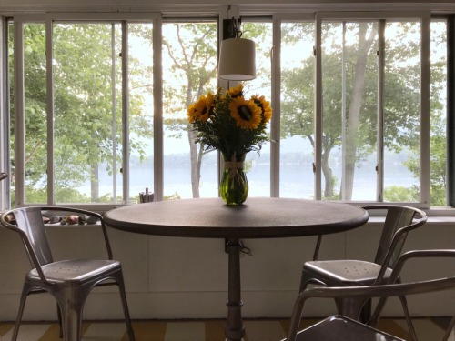 lake house porch with sunflowers.jpg