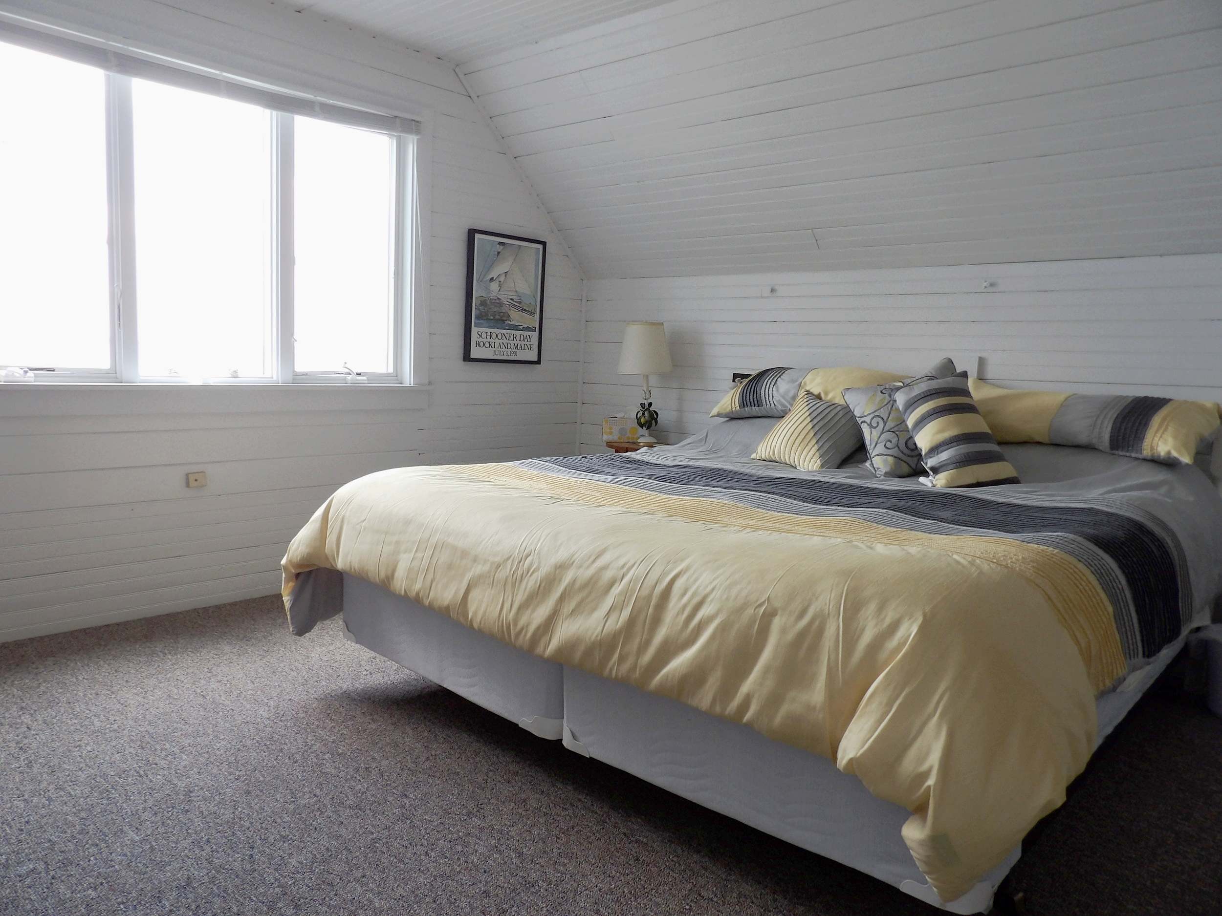 2nd Floor - Large Bedroom Overlooking the Water with King Bed & Ensuite Bath • Open Room with Two Twin Beds