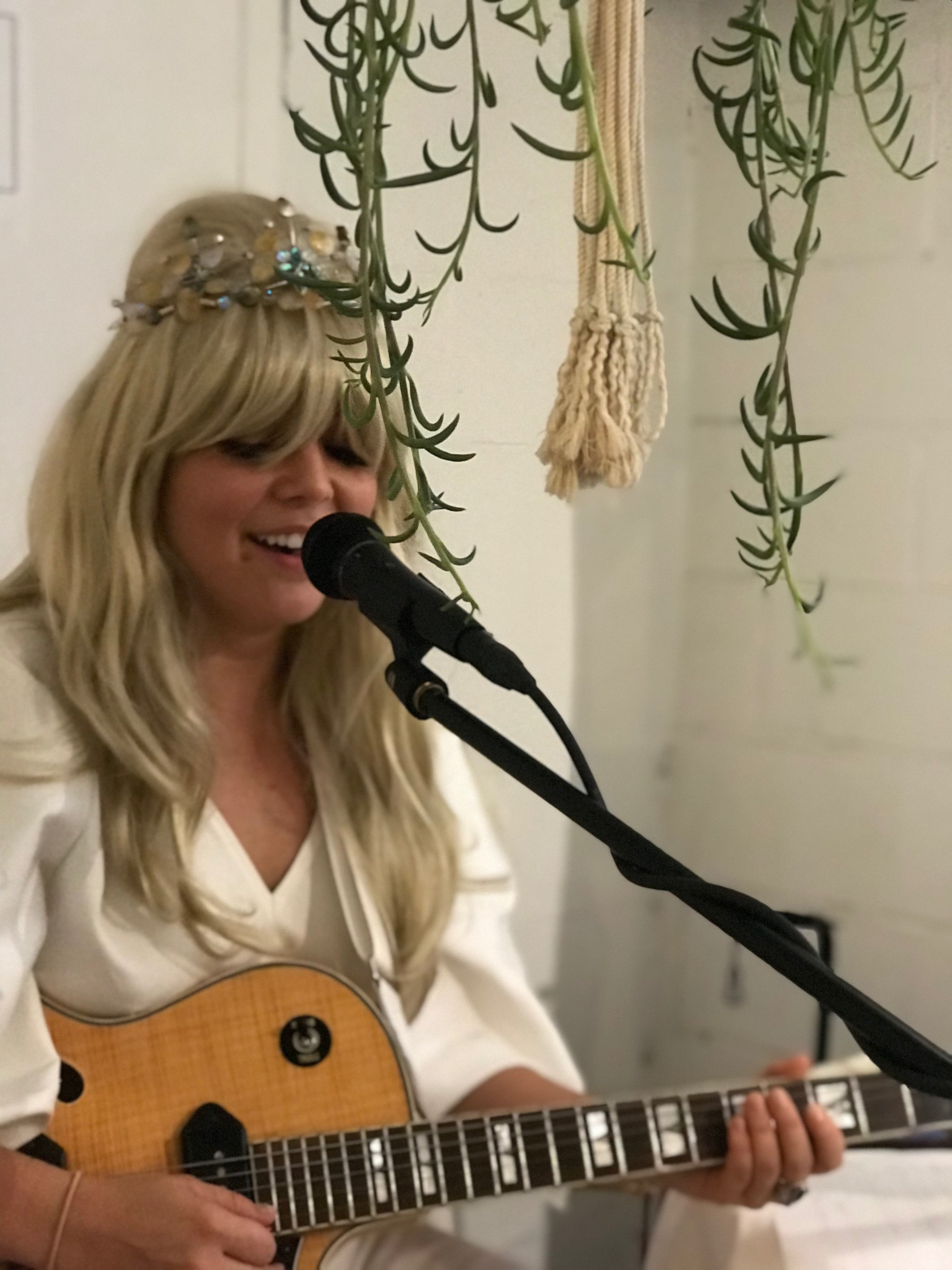 Courtney McKenna performing 'Sanctuary' at the opening of 'Flower Offerings'