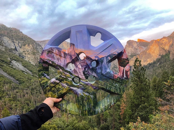 Mariah Reading,  El (Hub)Capital II (Yosemite National Park) , Photograph of acrylic on hubcap, 24 x 24 x 5 in., 2018, Courtesy the Artist.