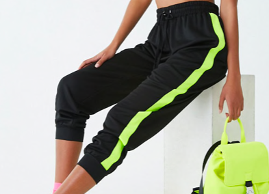 Track pants with neon green stripe -