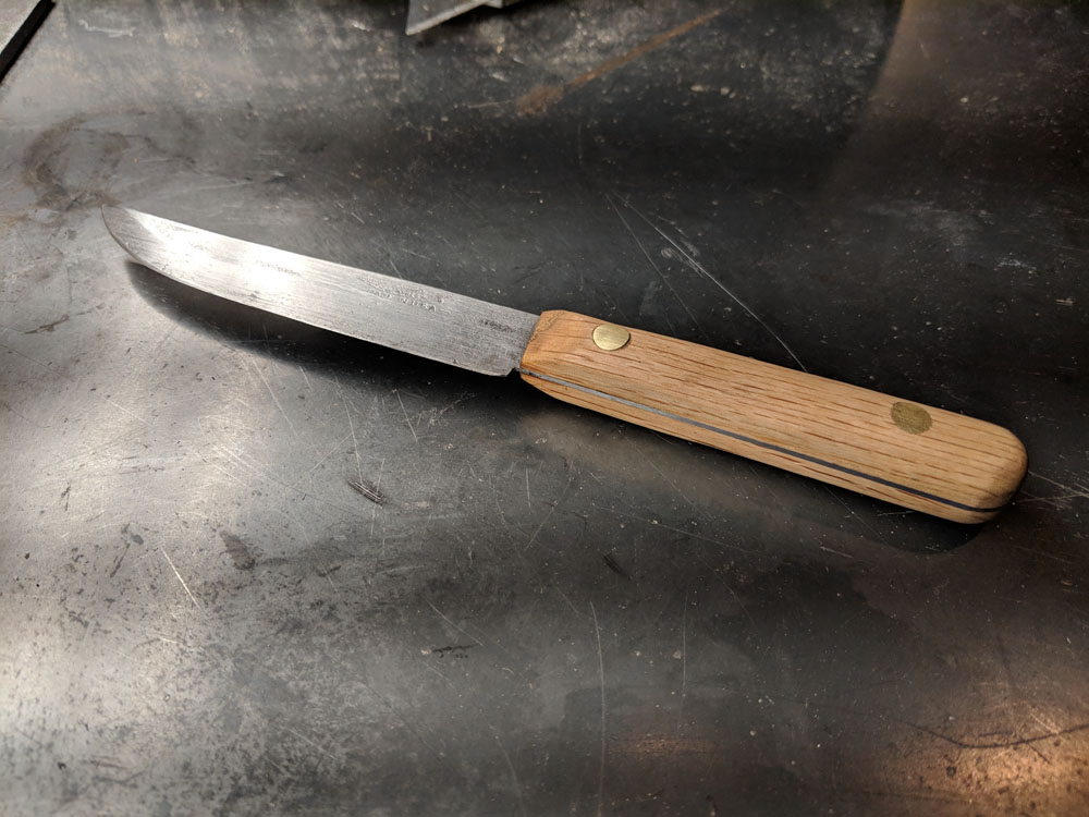 The finished product! Once it was all oiled, I sharpened the knife using a whetstone. Ready for service in the kitchen!