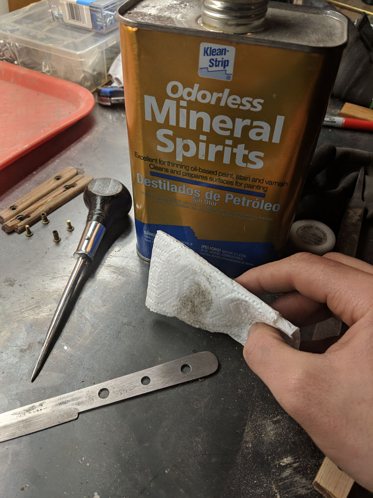 I cleaned up the blade with mineral spirits in preparation for bonding the handles.