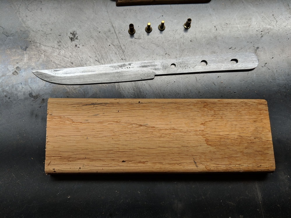 I found a scrap of what I think is oak trim or floor board to use for the handle.