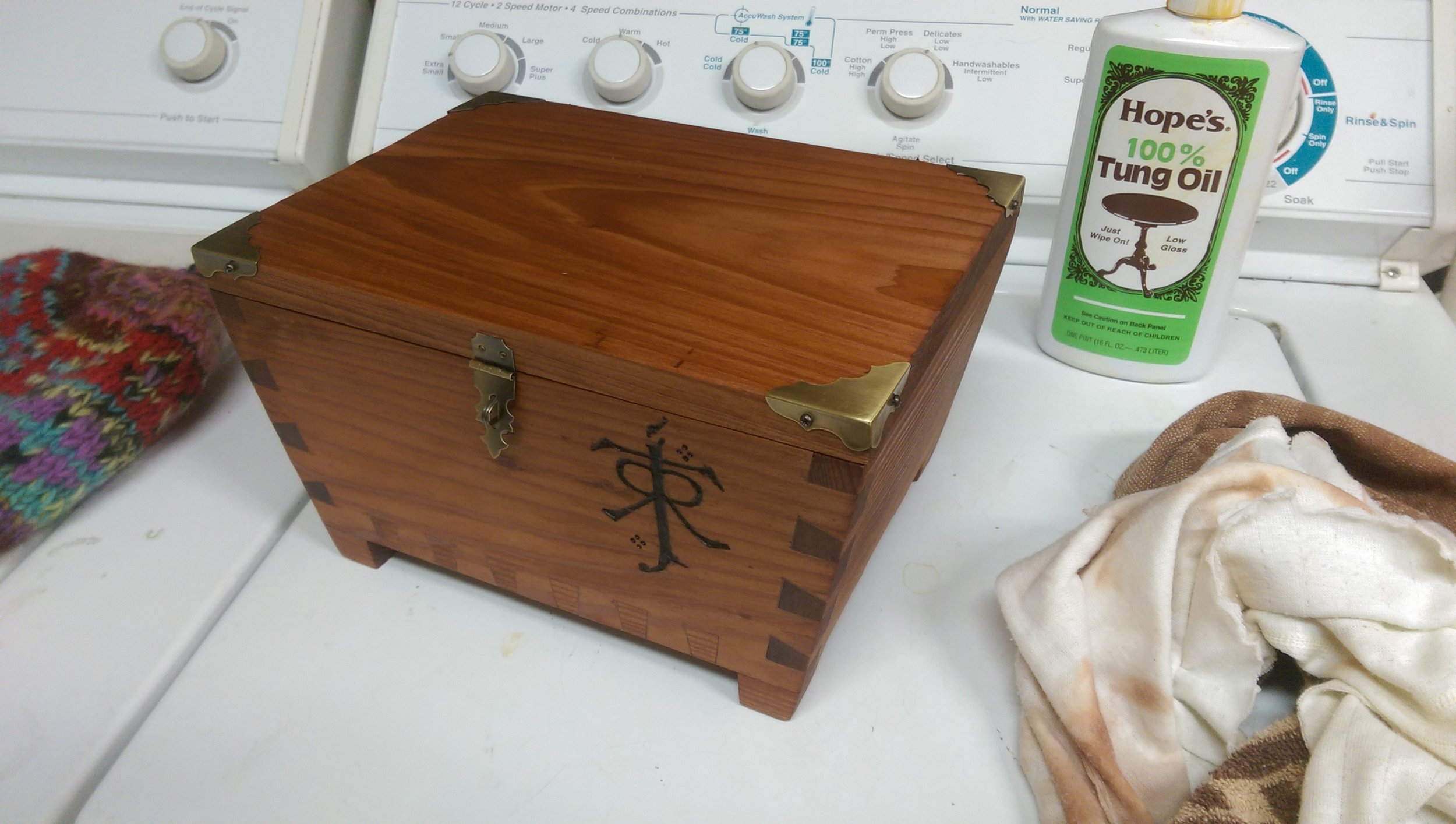 Finally I finished the box with several layers of tung oil. This really brought out the charred emblem and the wood's grain. Definitely the most satisfying part of the build!