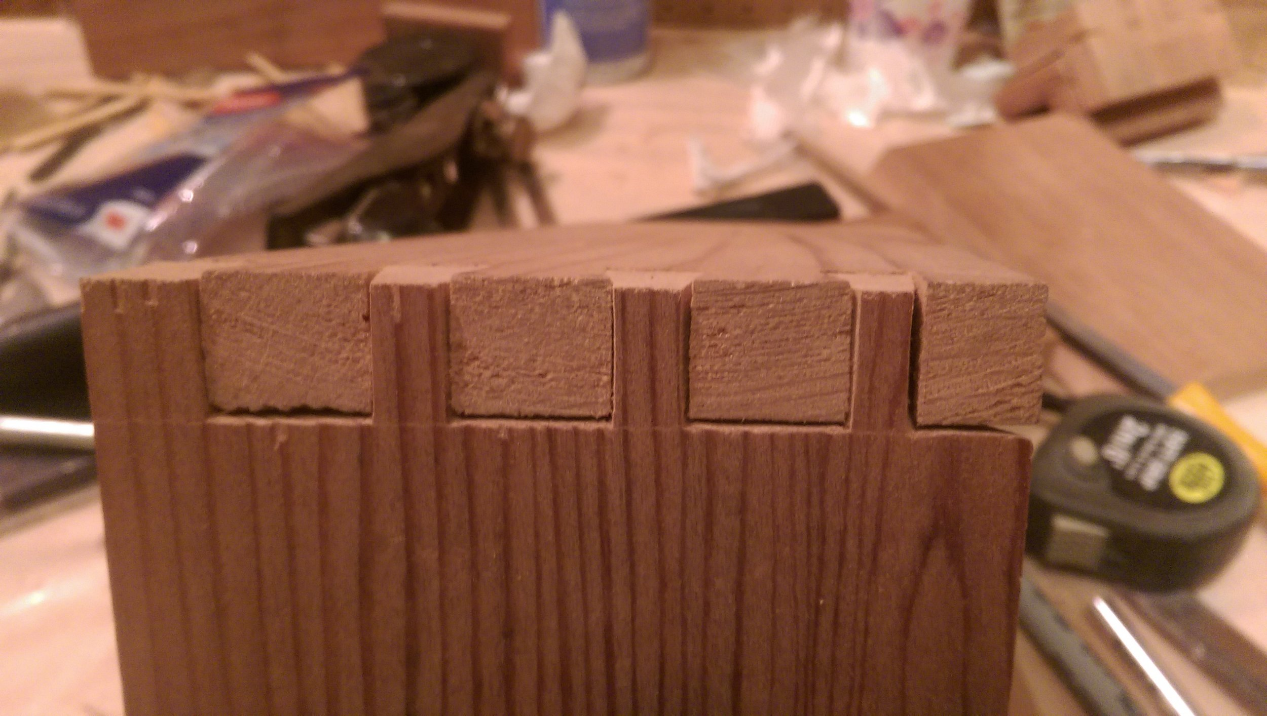 After a bit of massaging with a file, I managed to fit my first joint together. The test fit pretty clearly shows I'm an amateur at hand-cutting dovetail joints. The gaps are embarrassingly large. I was still excited when everything fit together though!