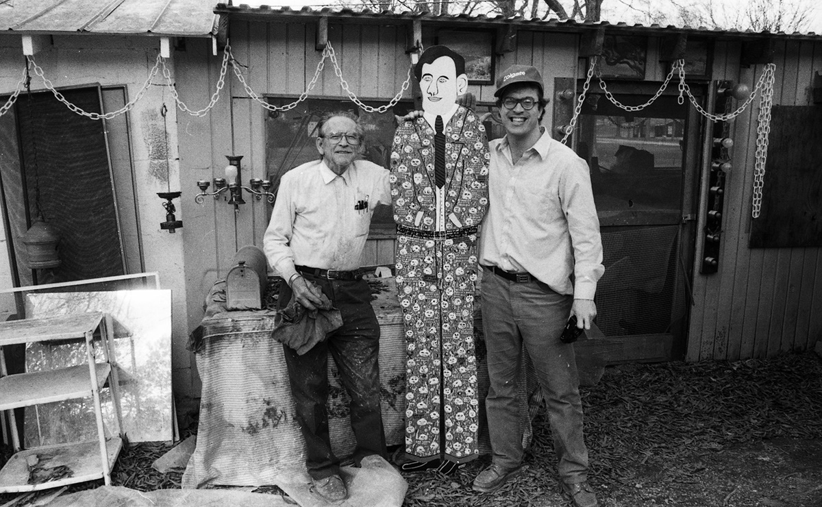 """Gene with Howard Finster.  One day Kevin Sartain was photographing Howard Finster (1916 – 2001, a Georgia artist and Baptist minister whose folk art sculpture garden had some 46,000 pieces of art) and brought Gene along to make a day of it. Says Sartain: """"What a complete blast."""""""