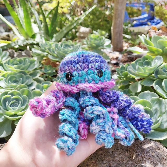 Don't be jelly of my jam 🍇. .  All shop orders are 15% till' the end of July & I am including free patches for orders $15+ 🍑. Thank you all for your constant love & support! - - - -  #amigurumi #crochet #makersmovement #makersgonnamake #handmade #stocktonca #california #pastel #pink #blue #colorful #sea #ocean #jellyfish #octopus #sealife #fiberart #artist #handmade #bubblegum #delicious #anime #convention #craftfair #shoplocal #shophandmade #shopsmall #gift #baby #yarncircus