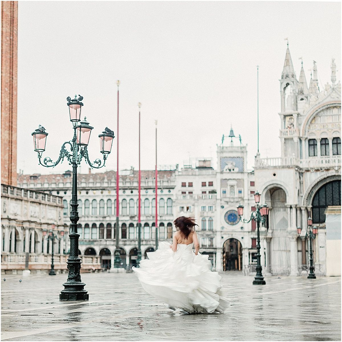 Bride running through Piazza San Marco Venice Italy.jpg