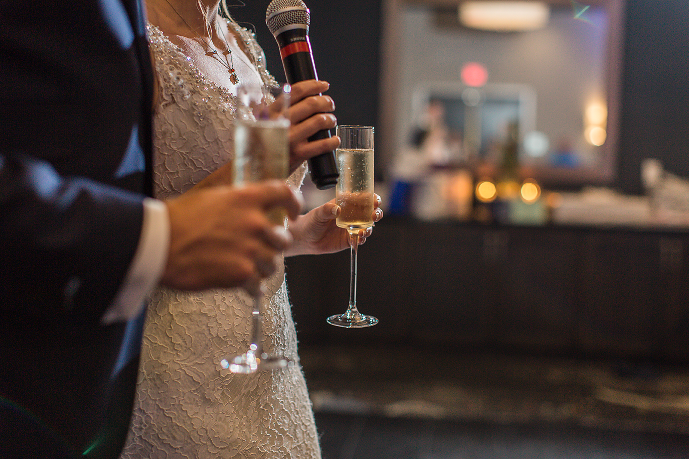 Dallas Wedding Photographer Greenville SC Embassy Suites Riverfront scottish wedding bride and groom toast champagne glasses kate marie portraiture.png