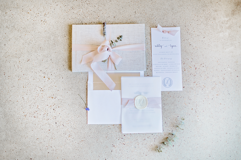 Dallas Wedding photographer Rustic Grace Estate invitation suite silk ribbon white wax seal monogram Kate Marie Portraiture.png
