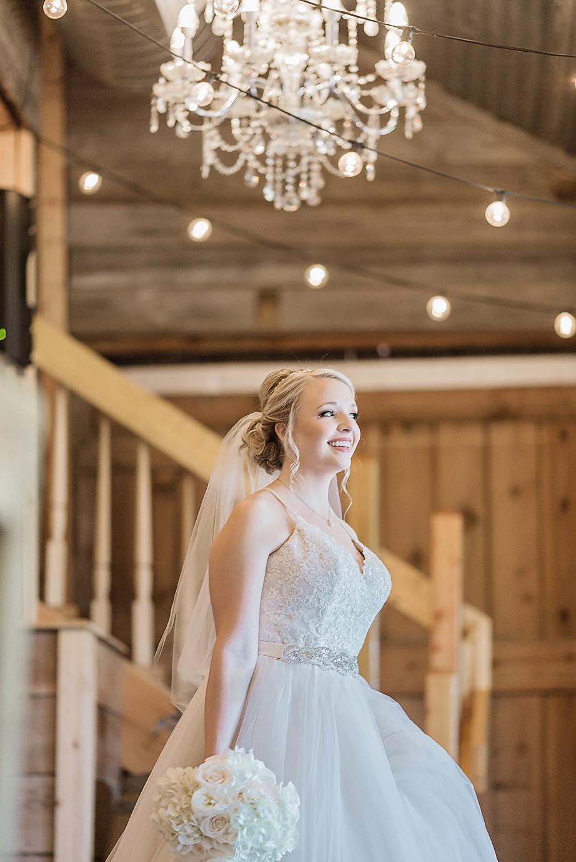 Dallas Wedding photographer Rustic Grace Estate bridal portrait barn chandelier Kate Marie Portraiture.png