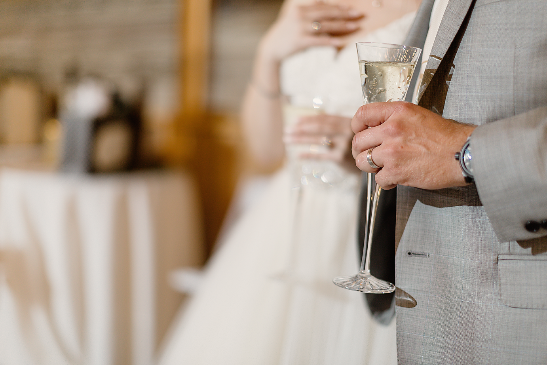 Dallas Wedding photographer Rustic Grace Estate bride groom toast champagne glasses Kate Marie Portraiture 1.png