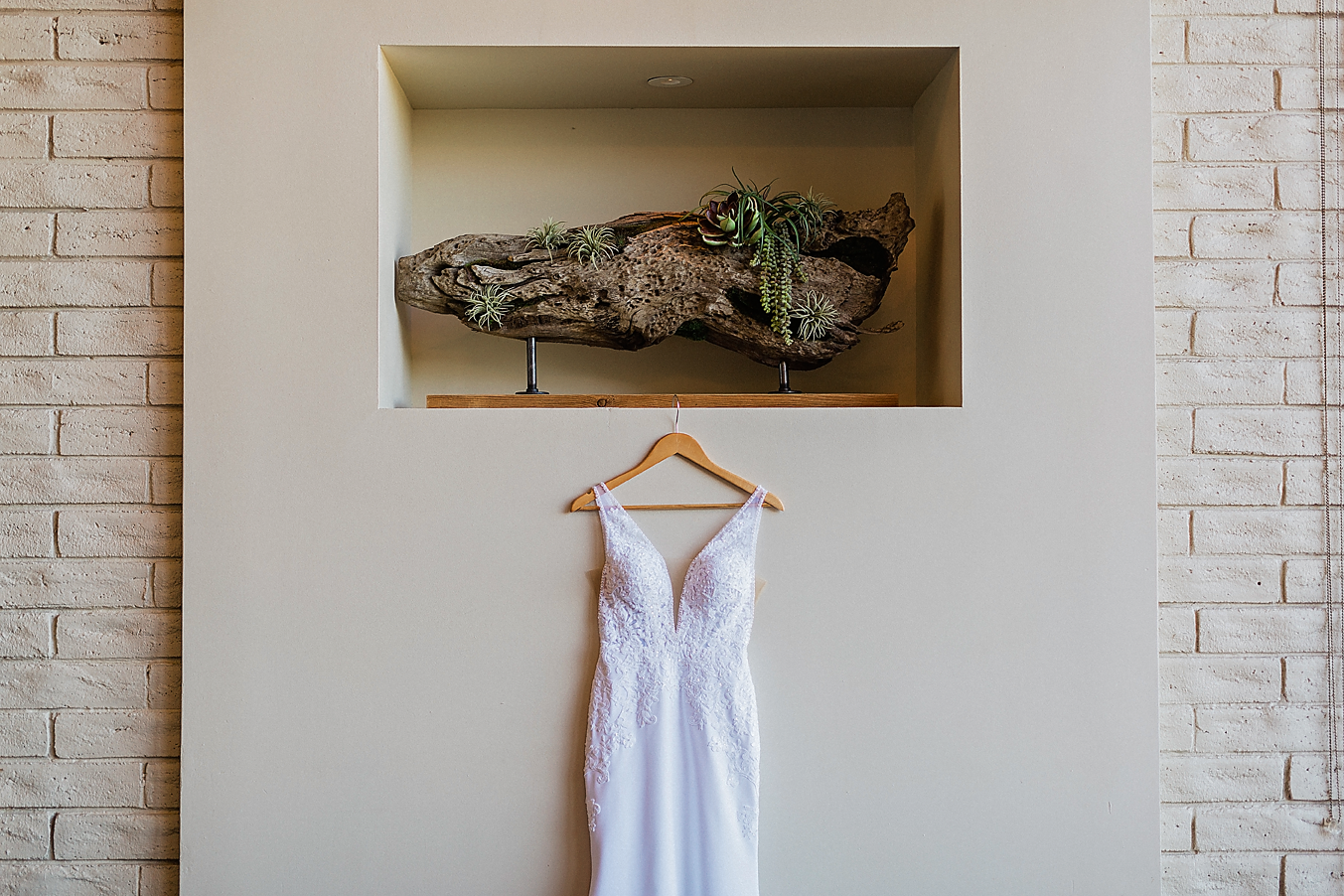 Dallas Wedding photography Las Colinas Country Club brides dress hanging Kate Marie Portraiture.png