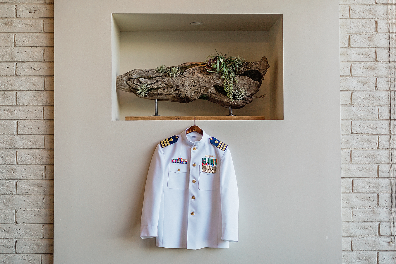 Dallas Wedding photographer Las Colinas Country Club grooms military coat hanging Kate Marie Portraiture.png