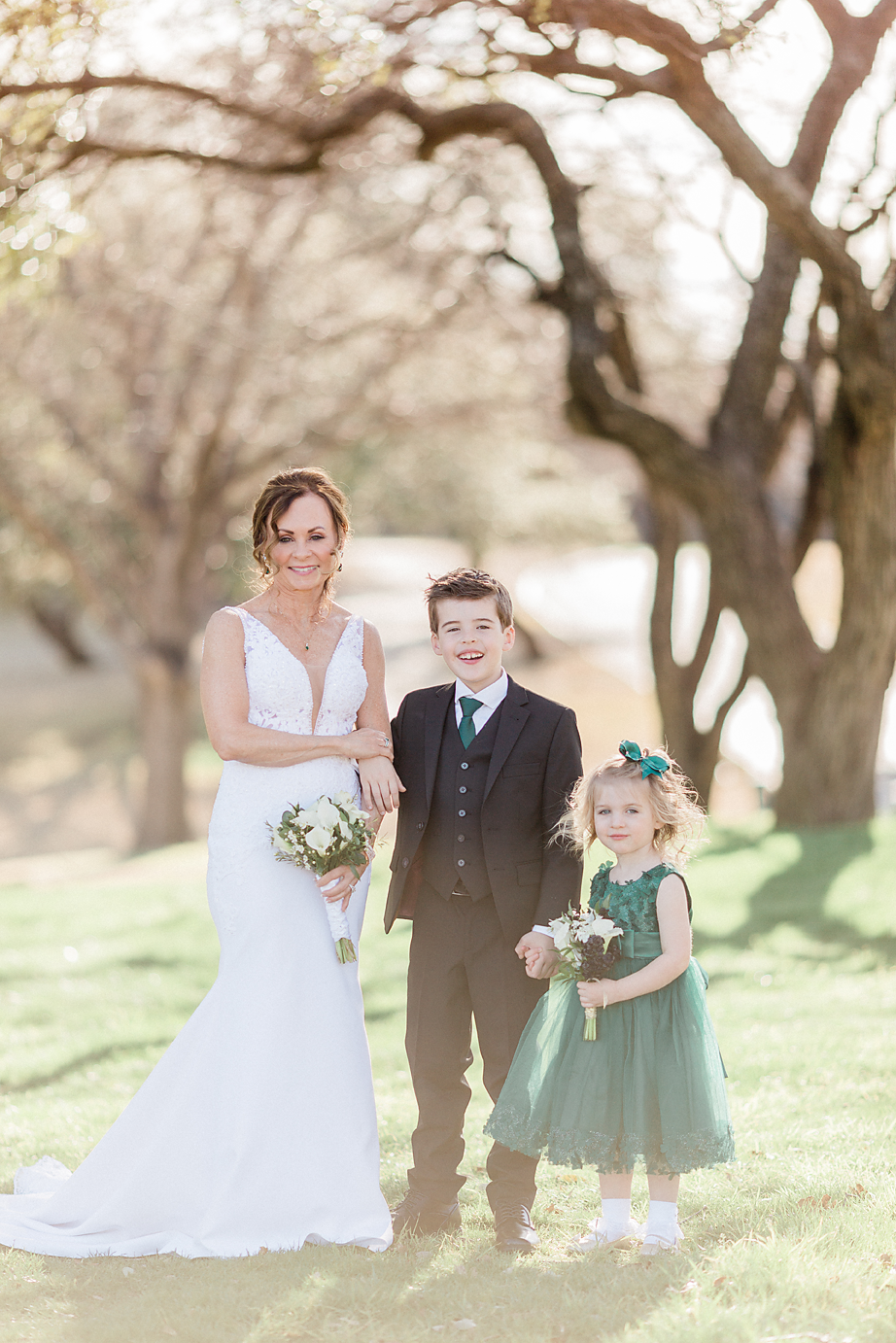 Dallas Wedding photographer Las Colinas Country Club bride ring bearer flower girl Kate Marie Portraiture.png