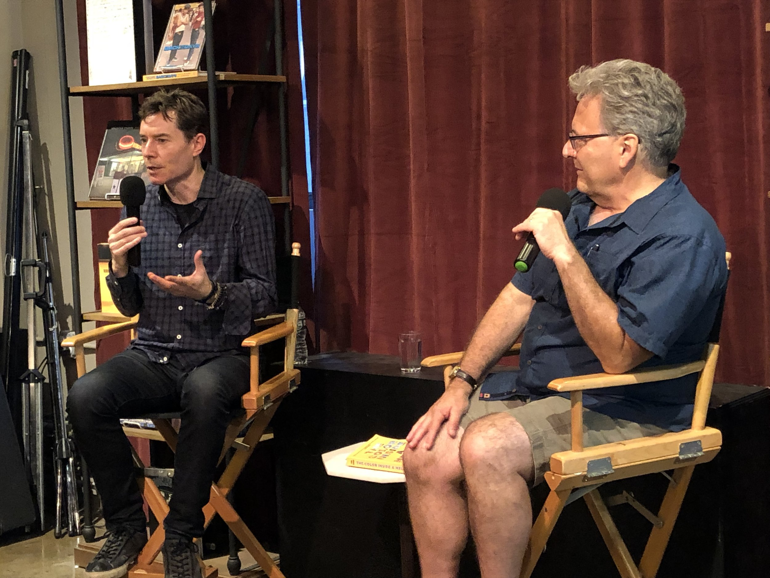 Christopher talks with author John Domini at the Powerhouse Arena bookstore, Brooklyn, July 2019