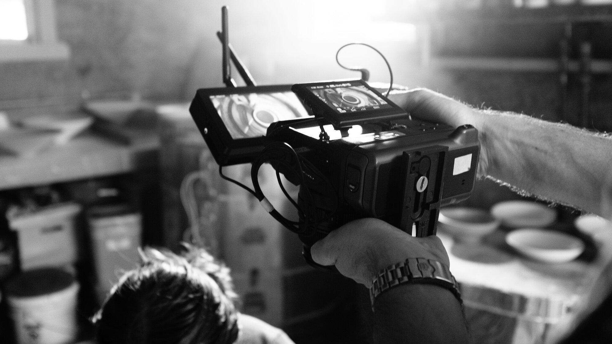 """The GFX 100 with the Focus Bolt 5"""" on top running wirelessly to a director's monitor."""