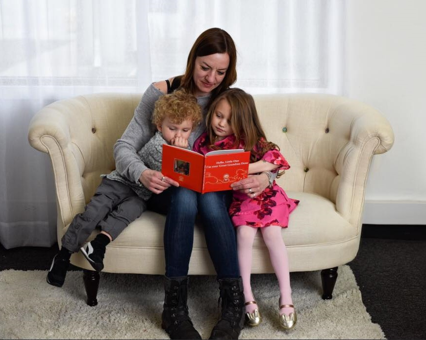 Mom reading book to children.jpg