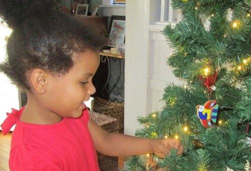 girl admiring christmas tree.jpg