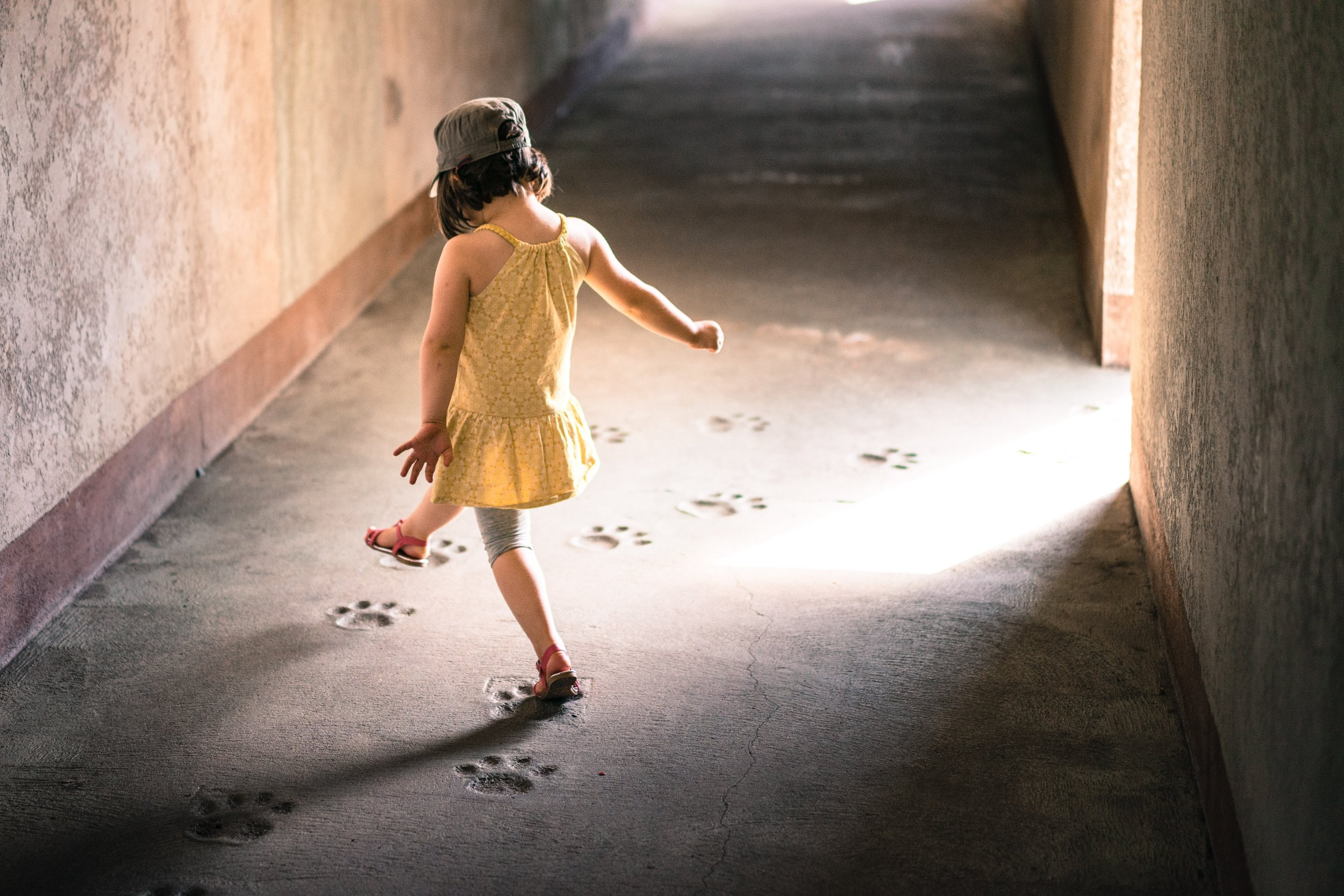 A little girl walking in the path of paw prints. Change it up to feel better. Photo by  Hugues de BUYER-MIMEURE  on  Unsplash