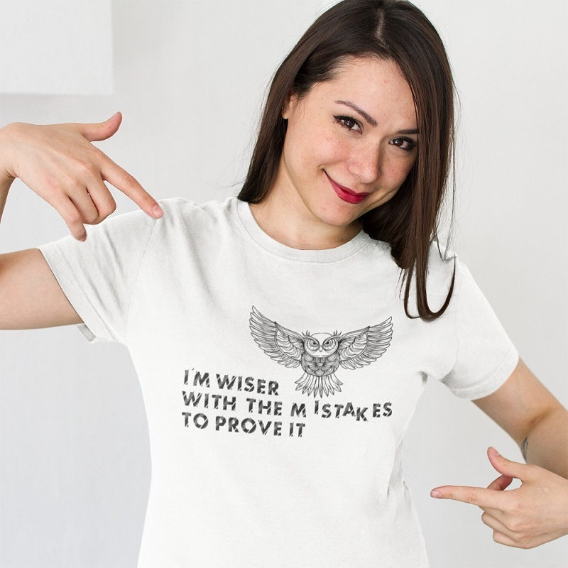 Woman wearing the Storied Gifts Shop Wiser t-shirt.
