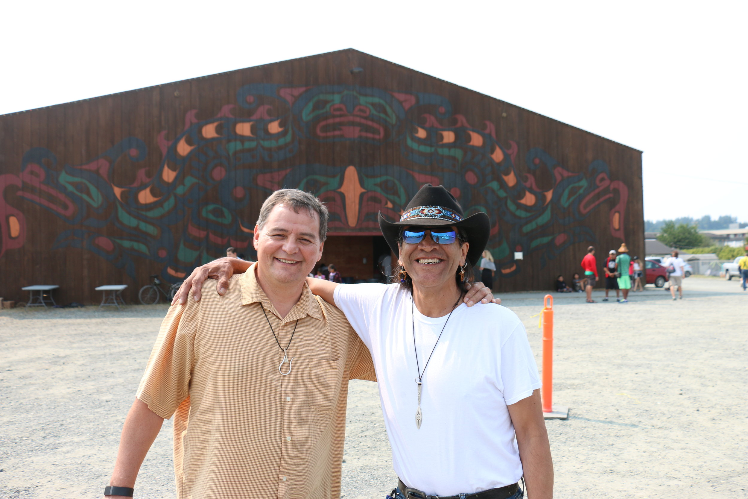 Frank Brown, left, Heiltsuk from Bella Bella and organizer of the first Tribal Canoe Journey in 1986, catches up with Ed Archie NoiseCat, a friend from back in the day. (Julian Brave NoiseCat)