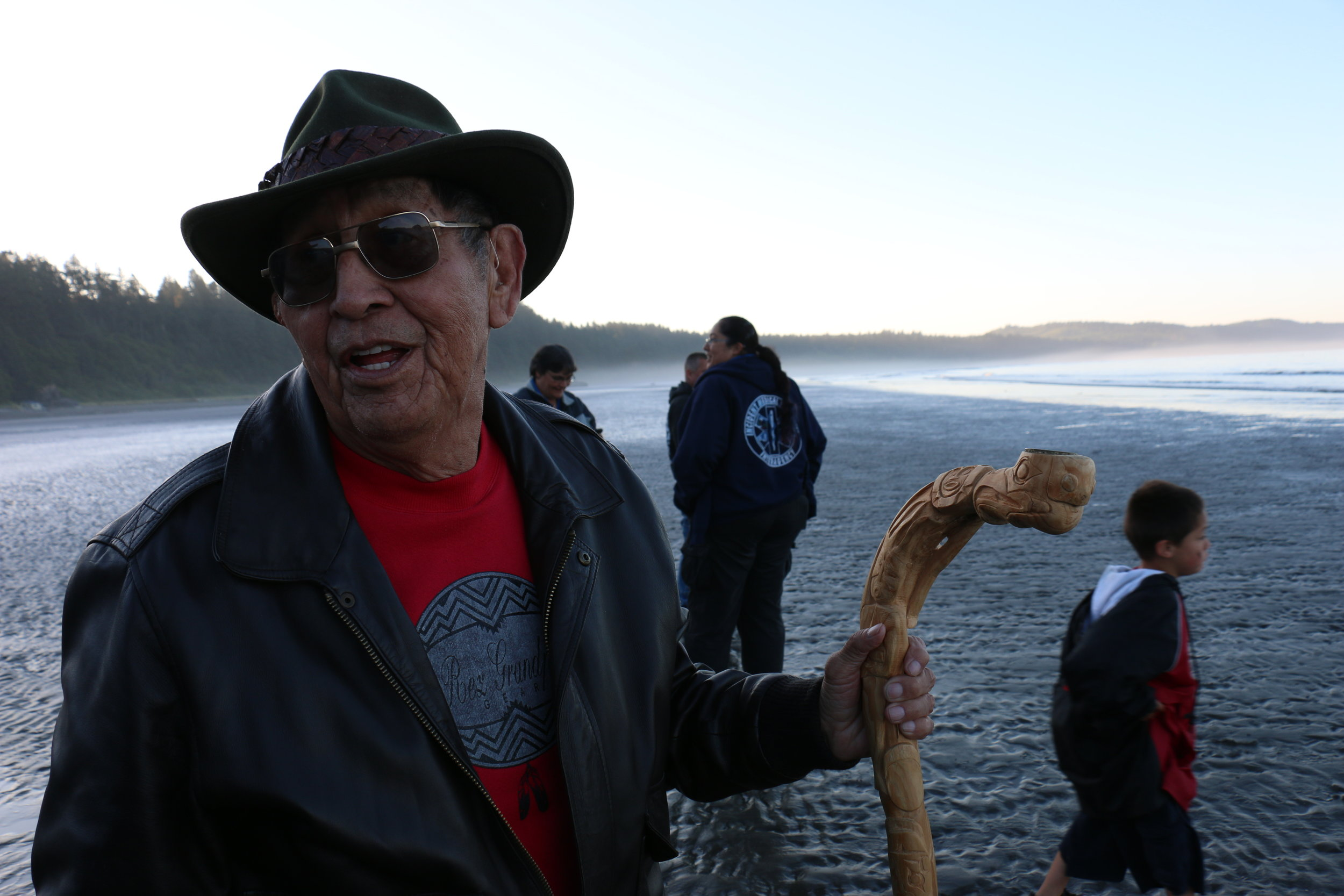 Harold Curley, a direct descendant of the legendary Chief Taholah who signed the 1855 Quinault Treaty, watches canoes depart in 2017. (Julian Brave NoiseCat)