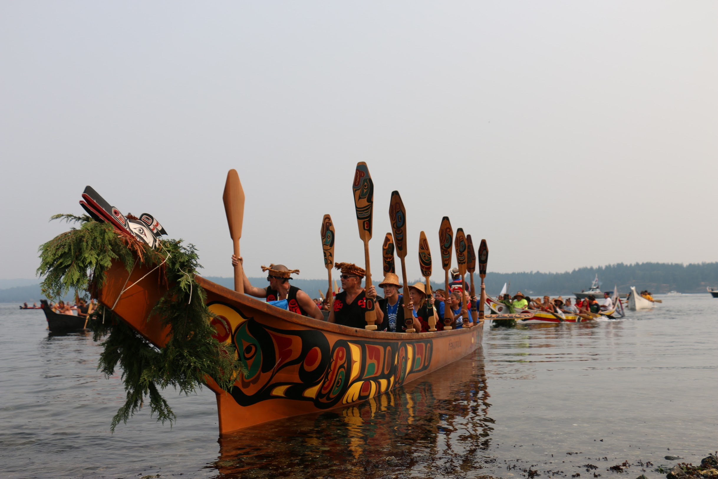 A canoe representing the Wei Wai Kum Nation leads canoes ashore at Tyee Spit near Campbell River, B.C., on August 5, 2017. (Julian Brave NoiseCat)