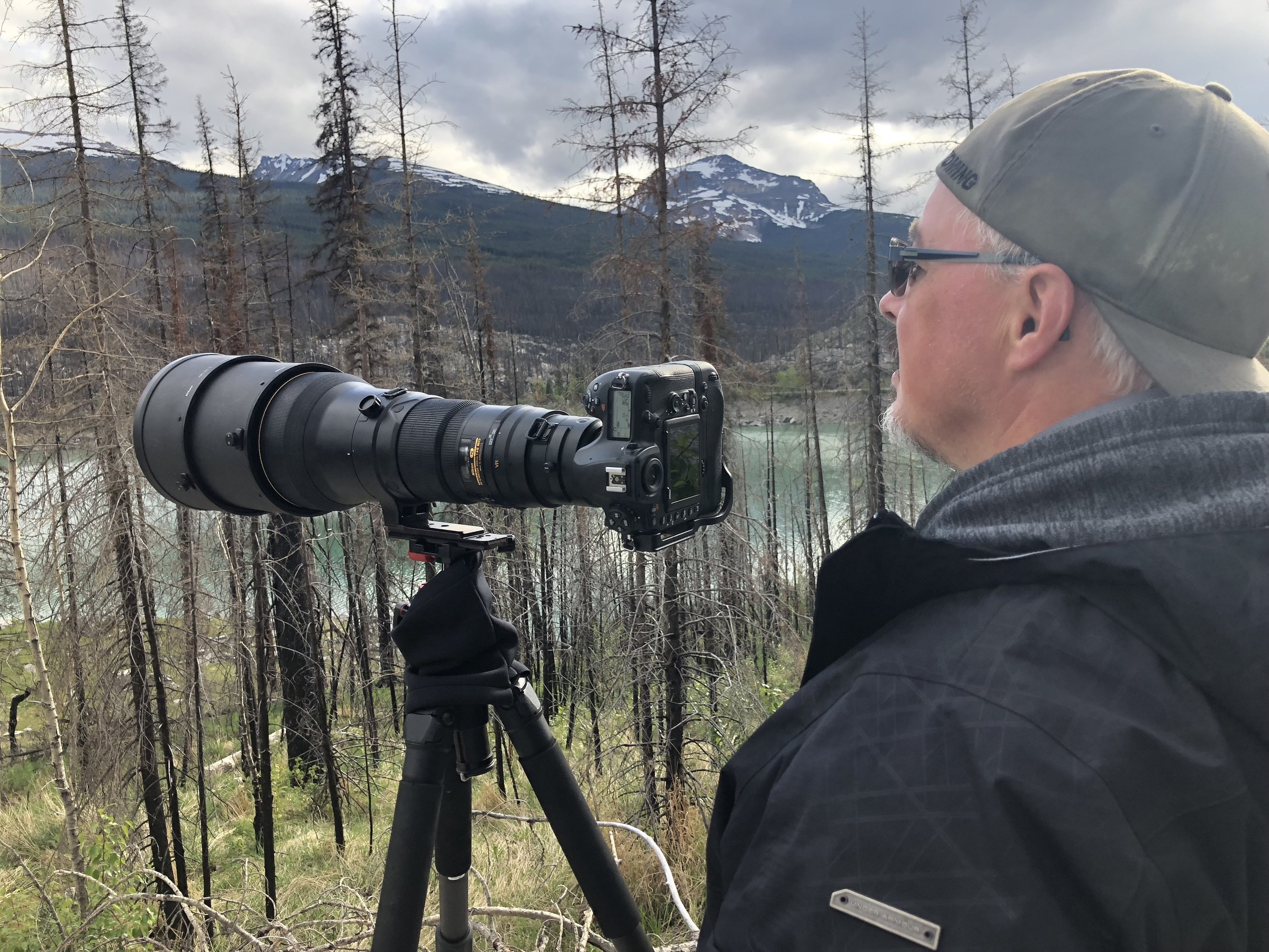 RON PHOTOGRAPHING IN ROCKIES.JPG