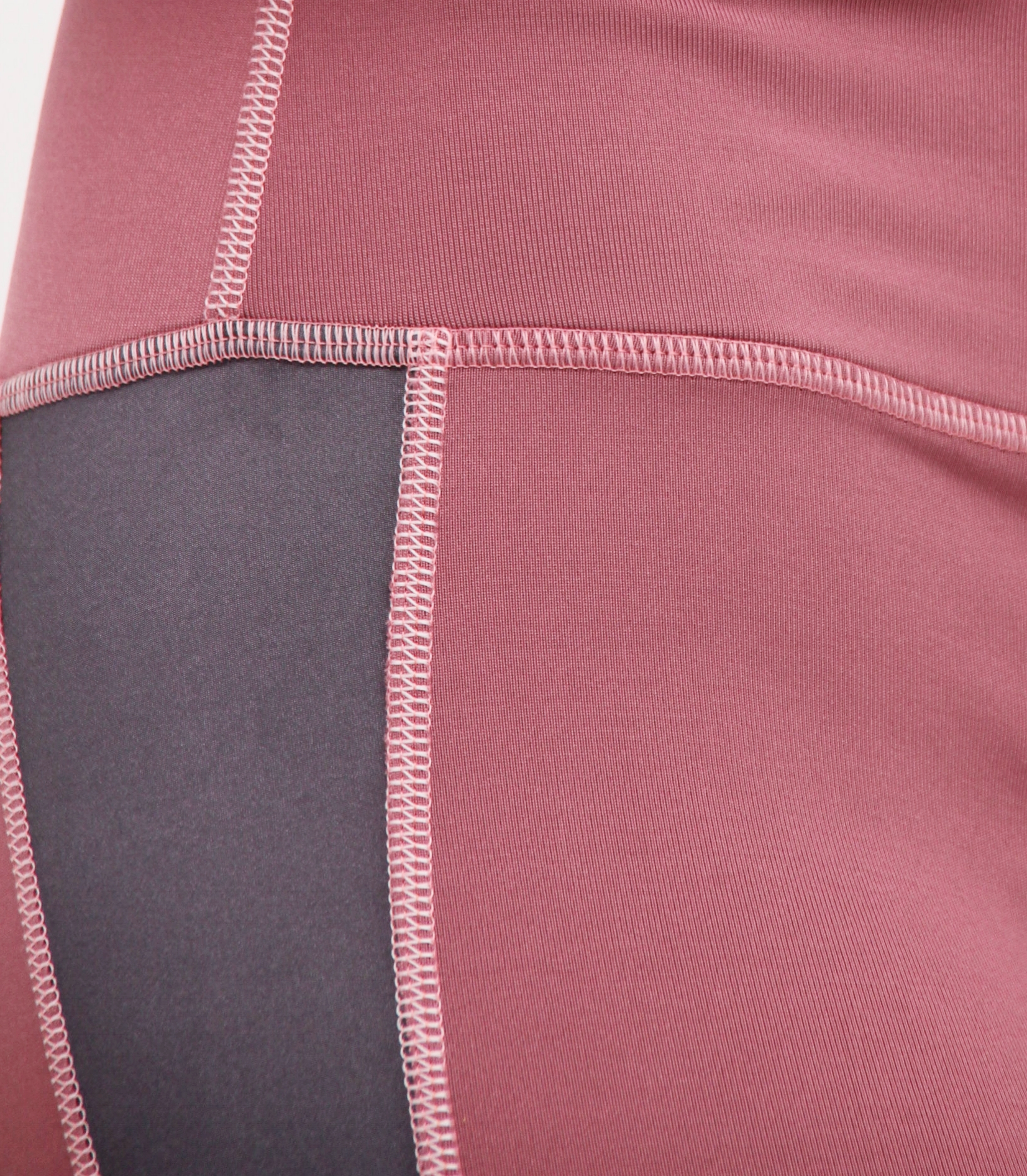 Uber-soft - A modern combination of dusty pink and Space Grey Lycra-blend material, this high moisture wicking and stretchable material is soooooo soft it'll glide over your skin like an intimate caress.