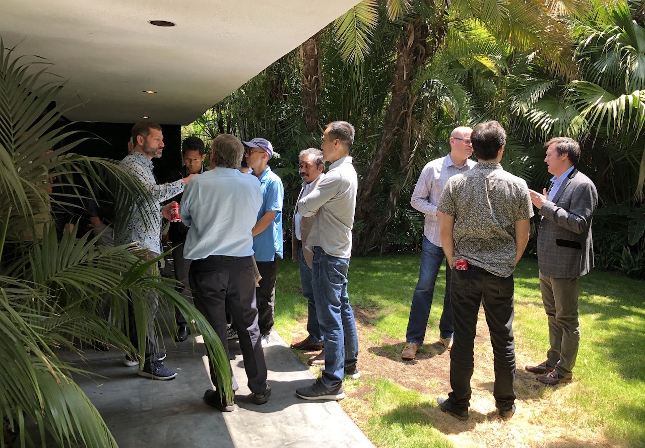 Apple Summit LA attendees chat outside the bungalow John Belushi did his last speedball.