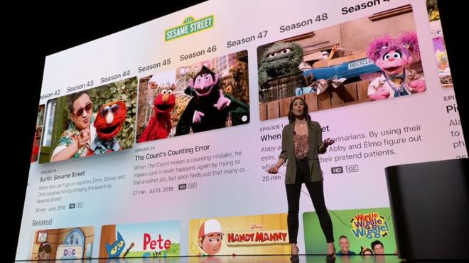 Cindy Lin, director of program management, demonstrates the new Apple TV app