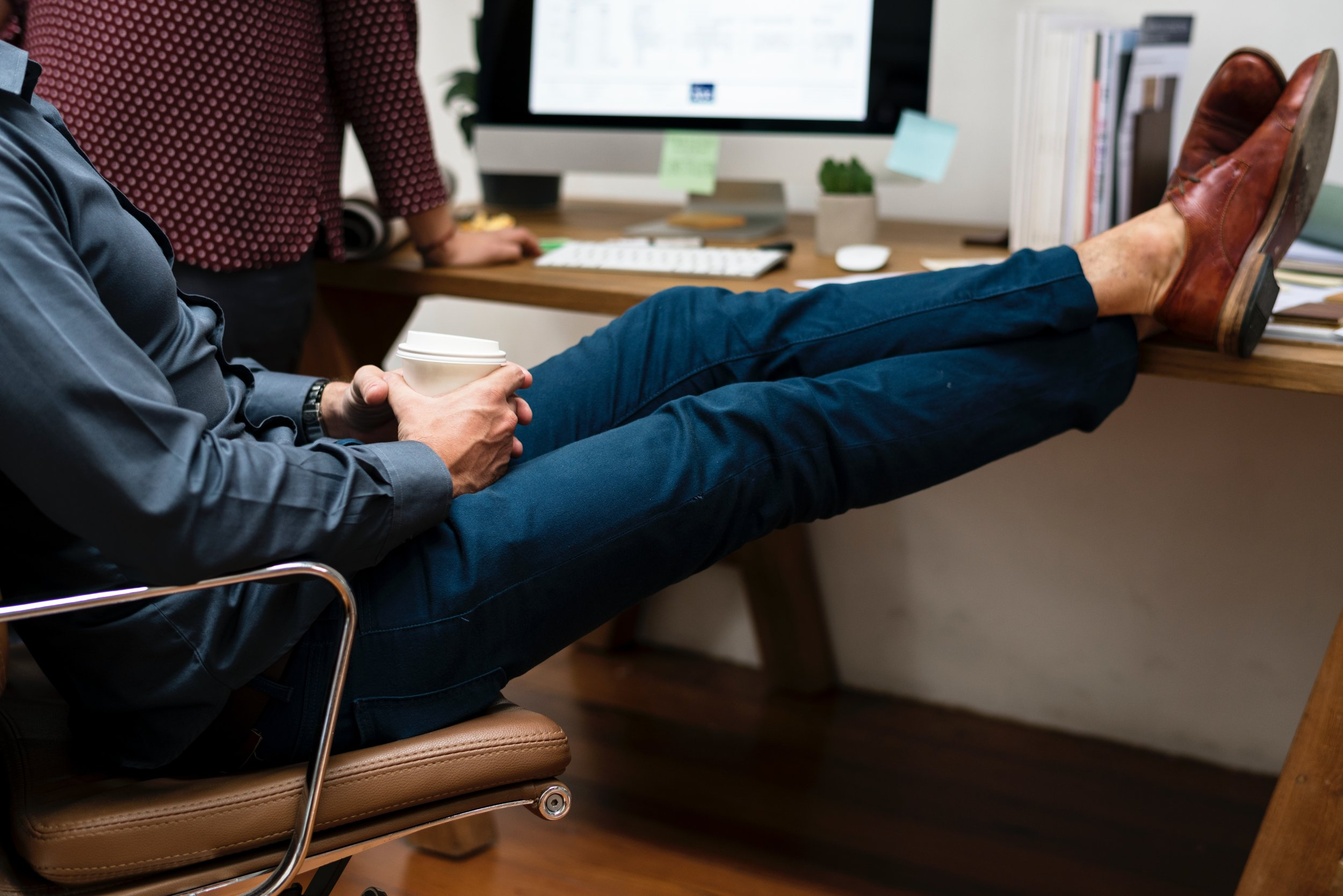 Is this you at your desk? Checking your posture regularly will bring you cognitive, psychological and physical benefits.