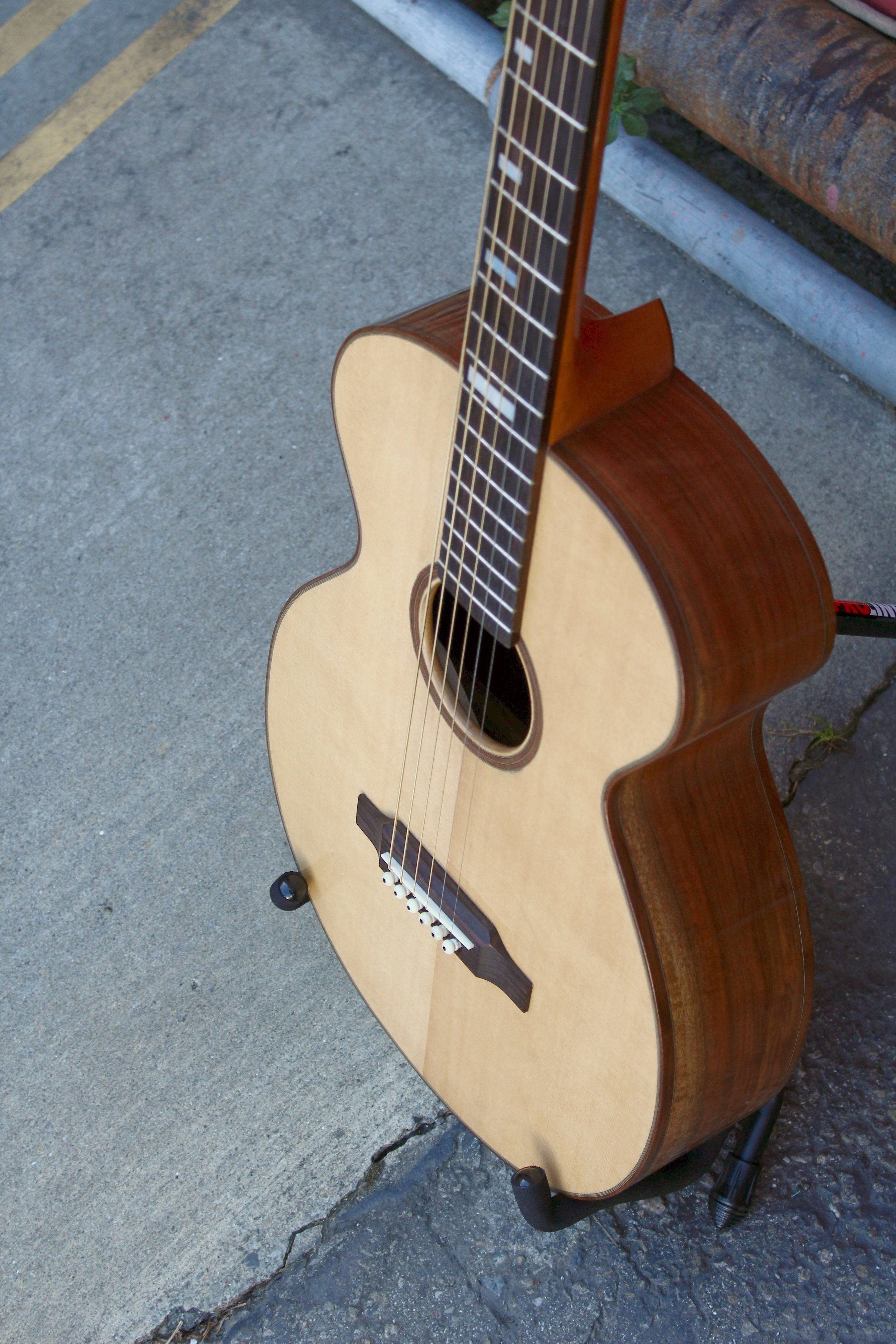 walnut and sitka acoustic guitar