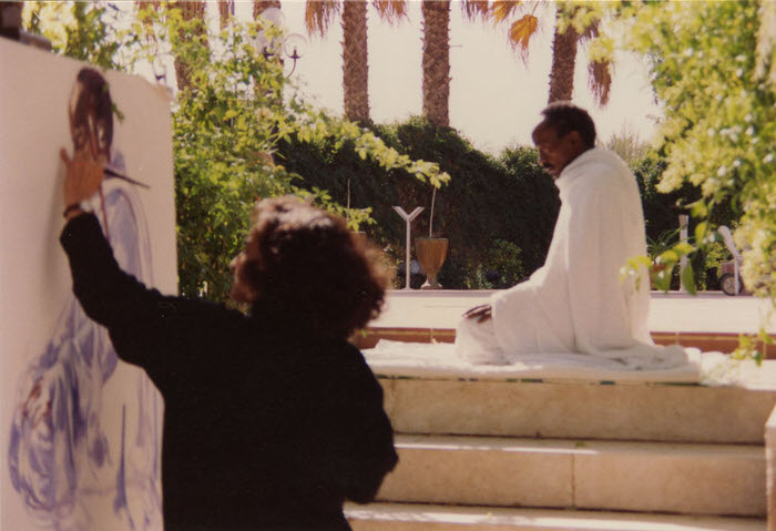 Halla painting Al Tahiyat, at the Artists' home in Riyadh, 1992