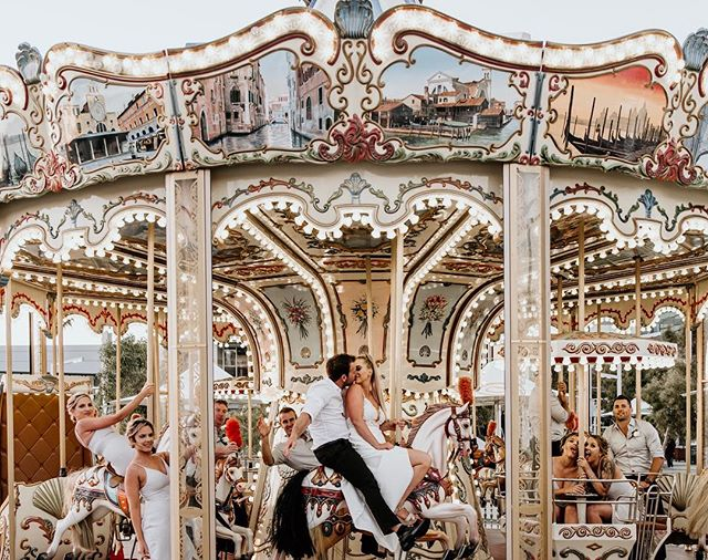 About yesterday ✨Kat + Bryce & their bridal squad are absolute goals 🤙🏻We saw a merry-go-round, begged the operator for a free ride and ended up with this cracker of a moment 🖤
