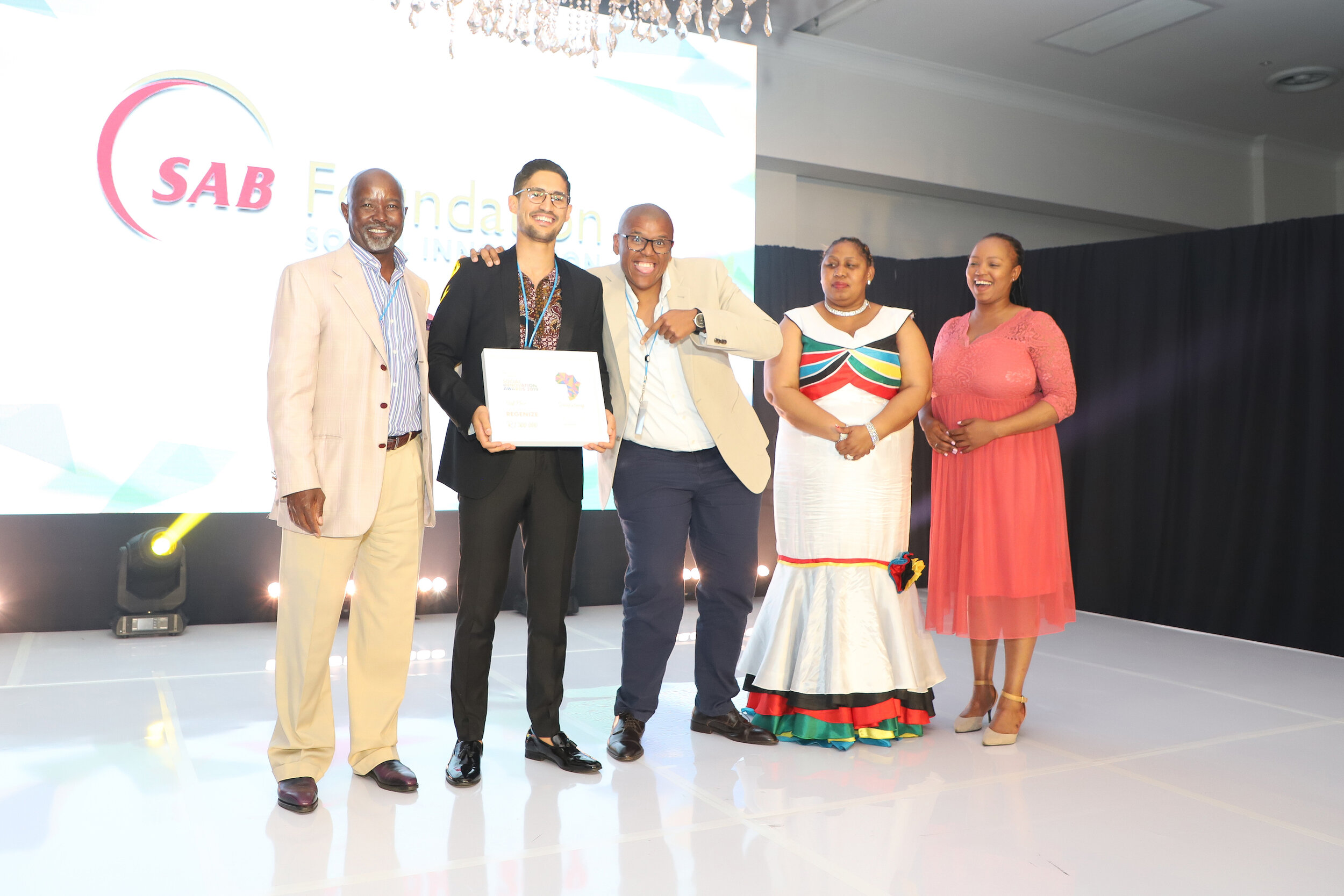 Pictured (left to right):       SAB Foundation Chairman and External Trustee; Moss Ngoasheng; Regenize, Social Innovation Awards winners Chad Robertson and business partner Nkazimlo Miti; Deputy Minister of Social Development, Hendrietta Bogopane-Zulu; and SAB Foundation Social Innovation Project Manager, Ntandokazi Nodada