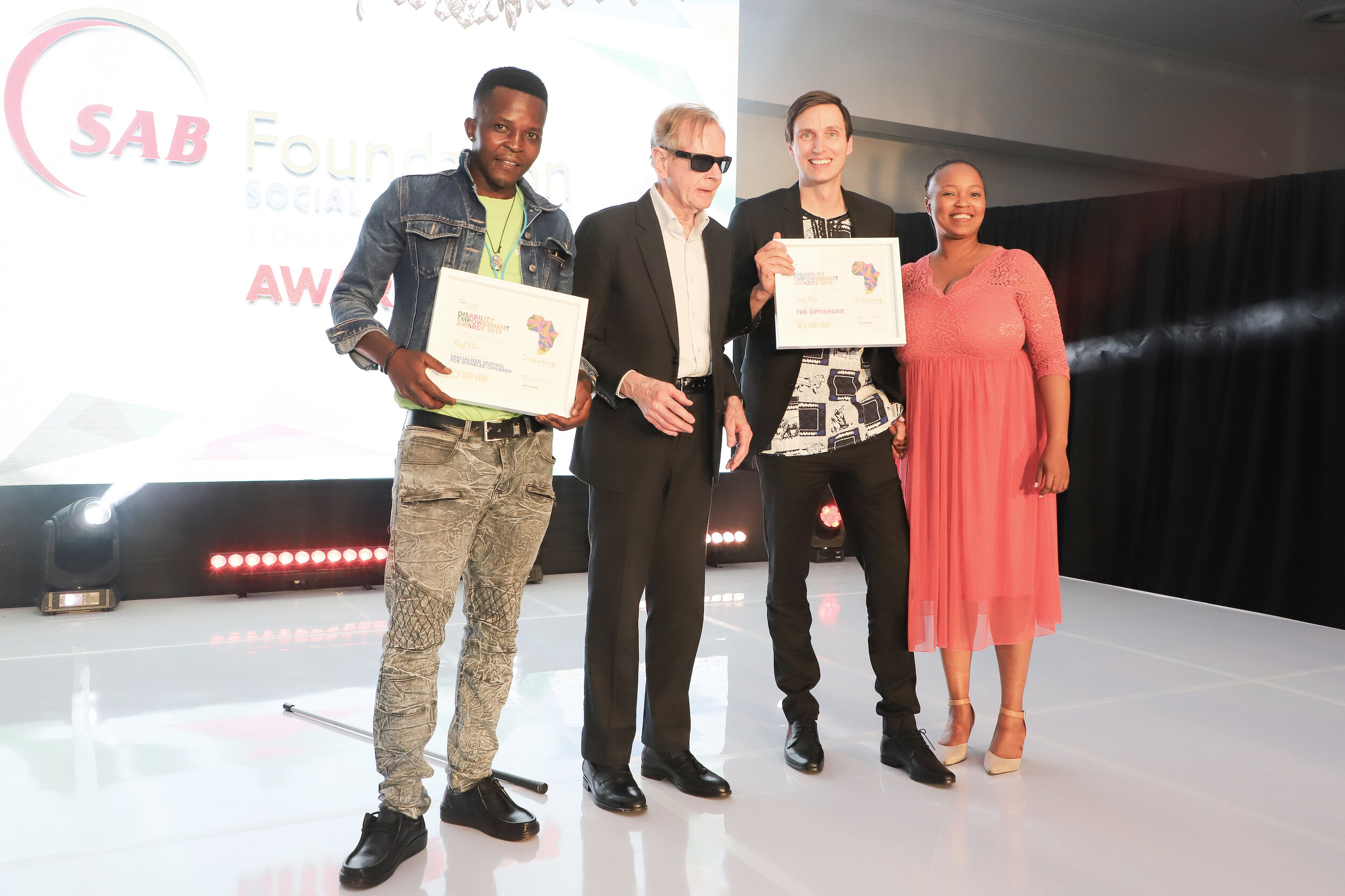 Pictured (left to right): Joint first place Disability Empowerment Awards and People's Choice awards winner, Mpho Mohlolo, developed Specialised Seating for Disabled Children; SAB Foundation External Trustee, Dr William Rowland; joint first place Disability Empowerment Awards winner, Dr Daemon McClunan with The OptiShunt; and SAB Foundation Social Innovation Project Manager, Ntandokazi Nodada