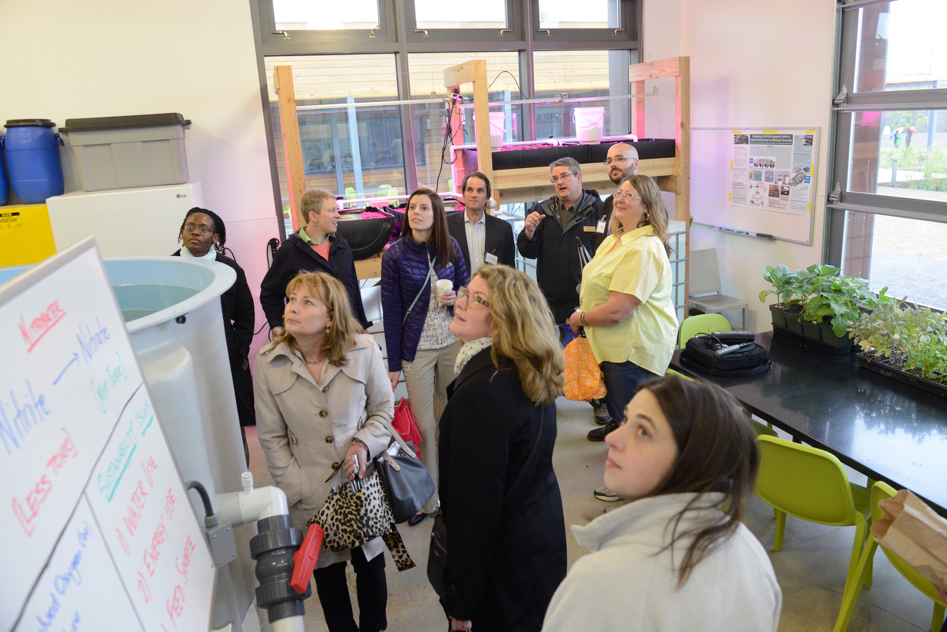 Roy Weitzell, PhD (back row, second from right) leads a tour of the Aquaculture Lab.
