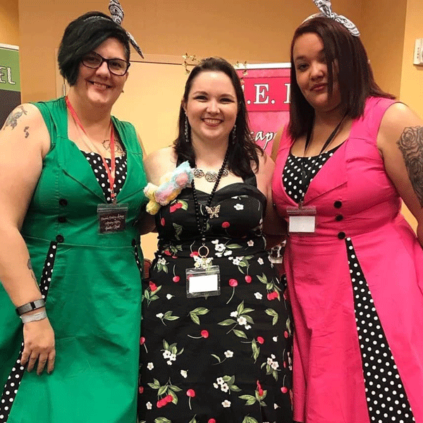 Rebecca and author friends at a signing in Michigan