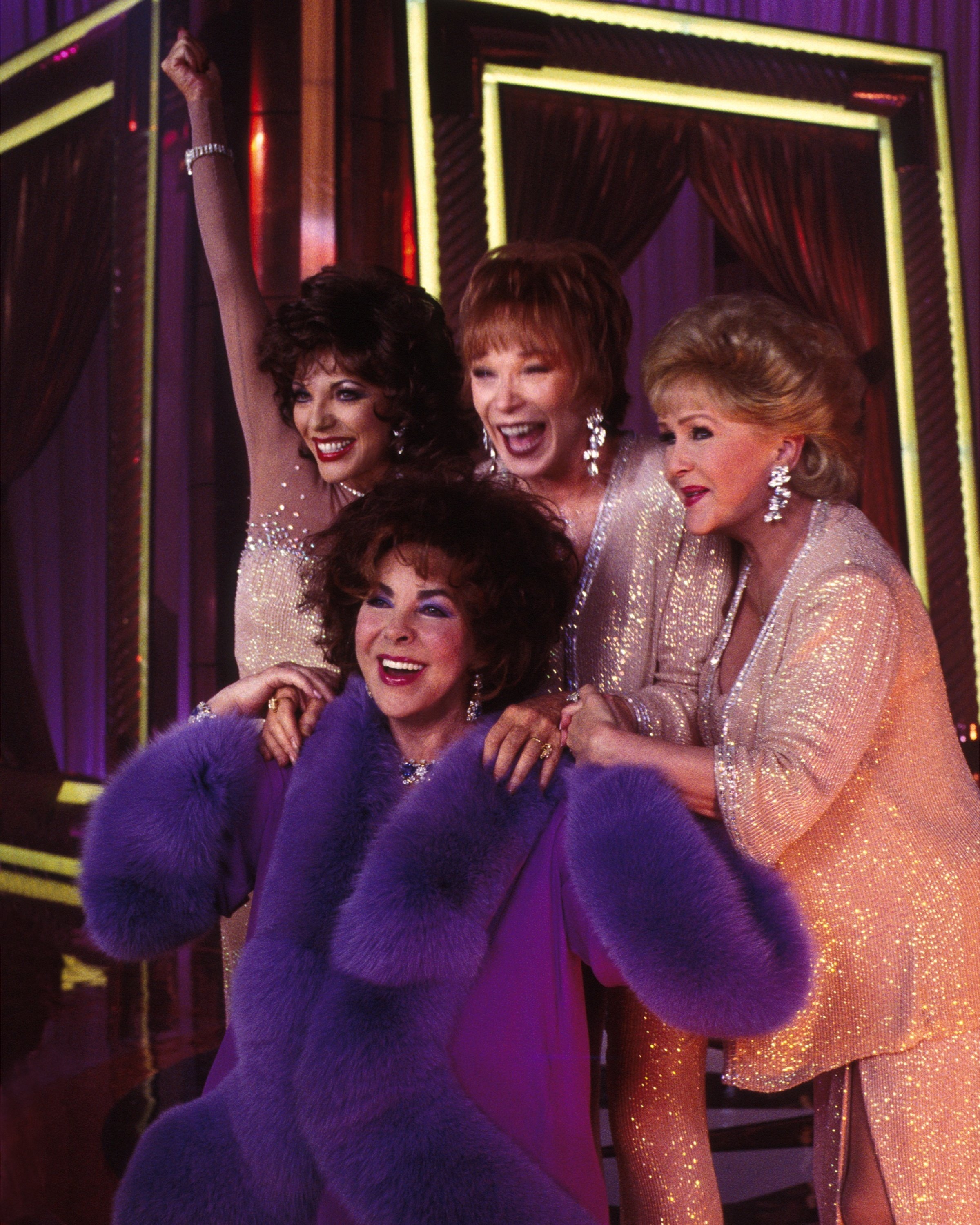 Elizabeth Taylor wearing purple fur outfit which is in the NS exhibition.jpg