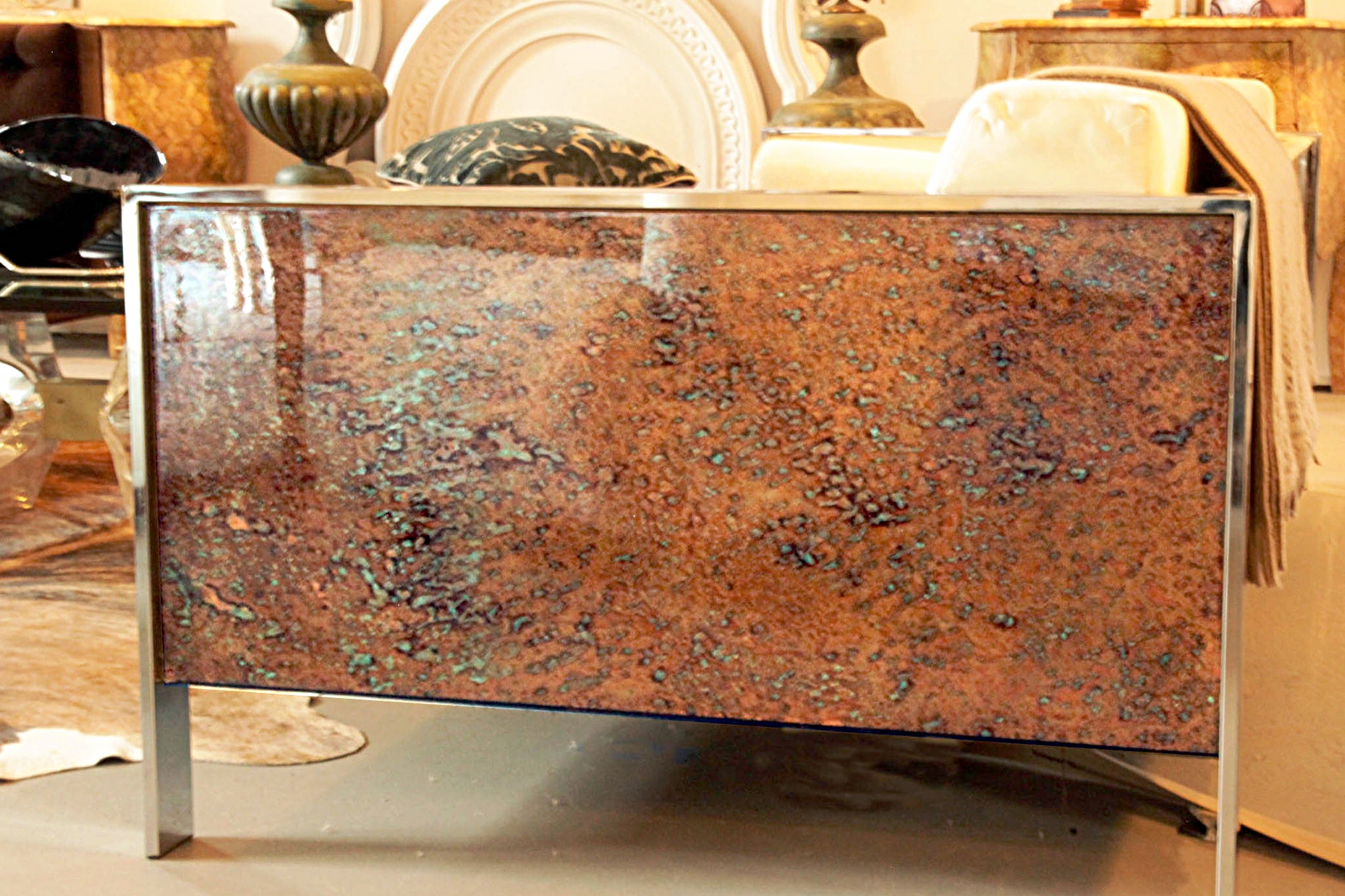 Detail of side of sofa; hand patinaed copper with bronze and turquoise colors.