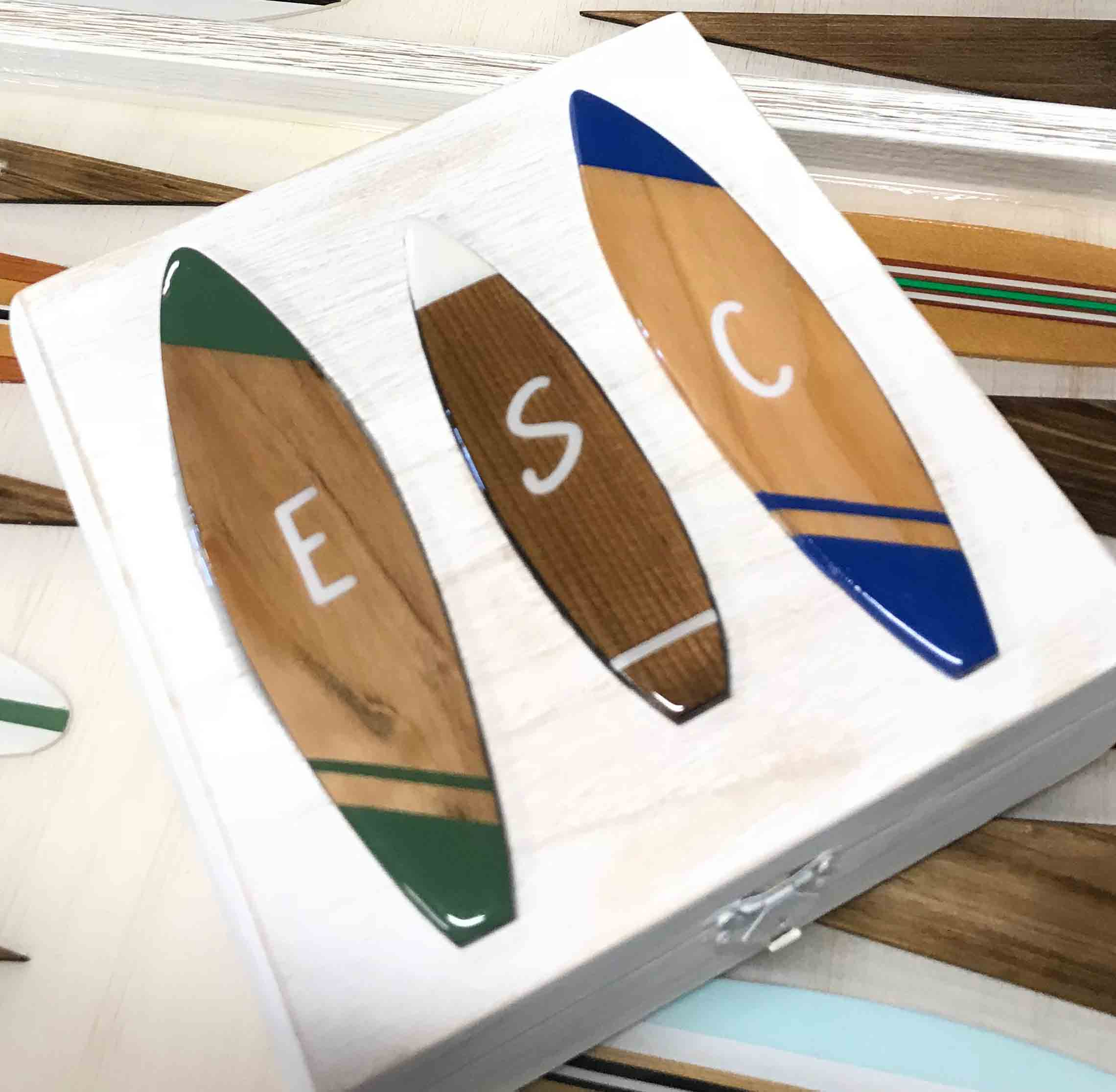 Playing checker box with hand decorated surfboards with custom initials