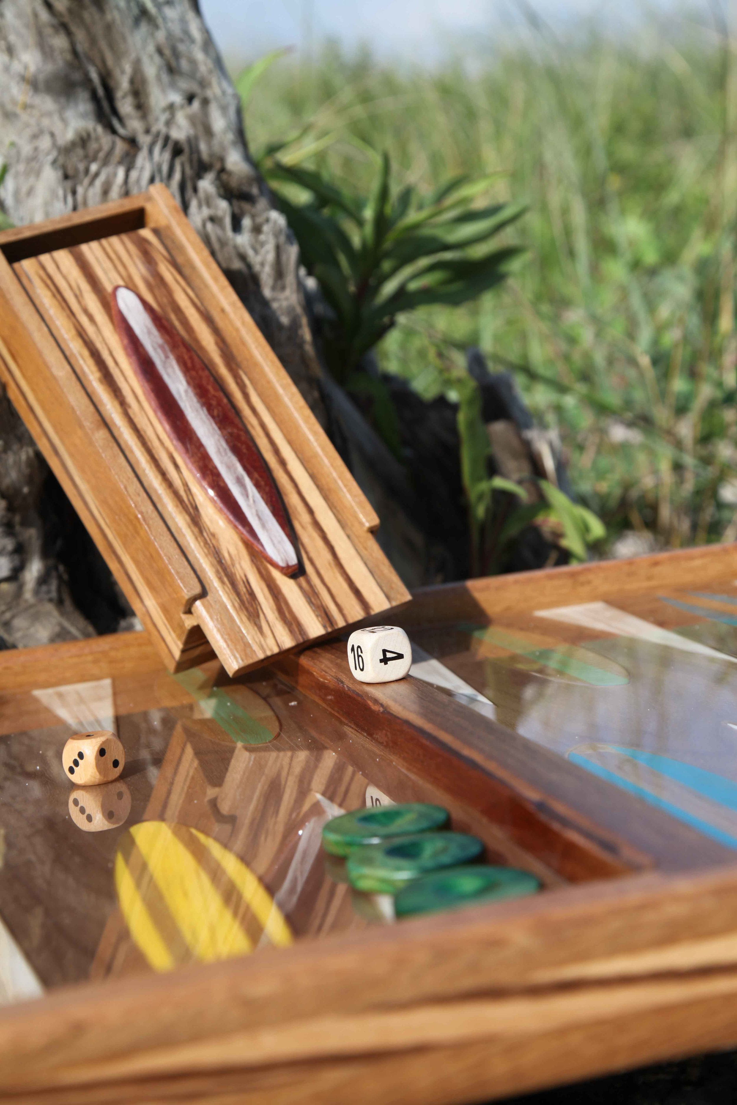 Playing checkers box for Big Sur: solid walnut with hand insets of African Zebrawood.