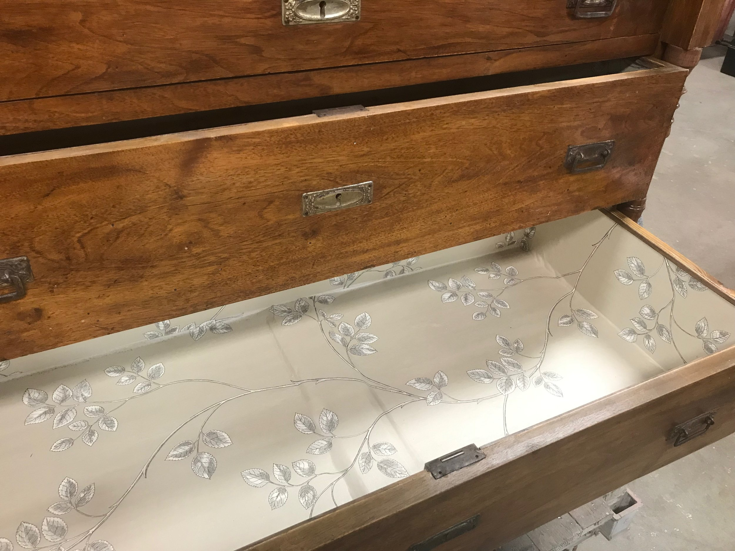 Lined the drawers with wallpaper client requested. added a trim to keep it clean looking and last longer.