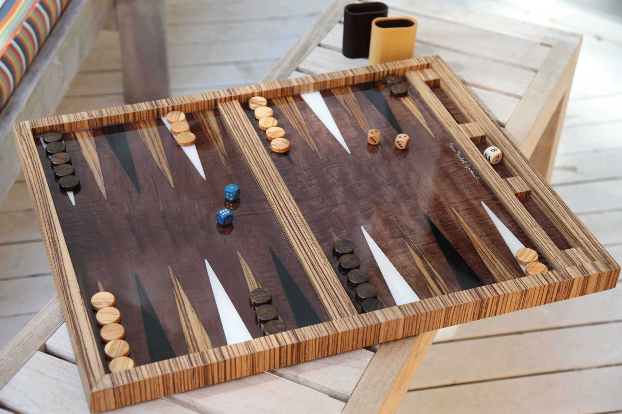Handcrafted Backgammon board with surfboard points trimmed with exotic wood
