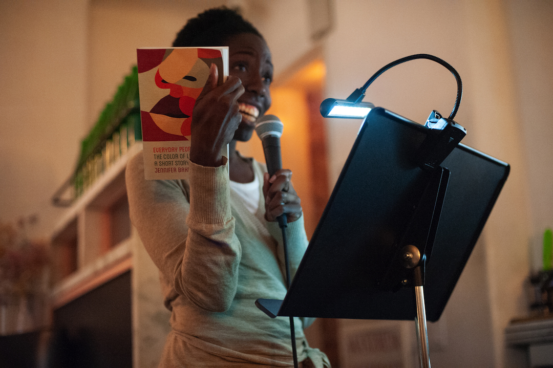 """Photo of Freya Project Reader Jennifer Baker with her own book """"Everyday People."""" Photo by Keira Chang."""